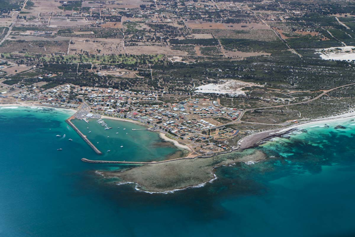 Dongara and Port Denison, seen from VH-ICE Cirrus SR22 GTS G5 (MSN 4063) owned by Andrew Dean - Sat 15 November 2014. View facing east. Dongara is a crayfishing town 351km NNW of Perth, with a small oil rig offshore. The airstrip is just off the photo to the right (south of the town). Photo © David Eyre