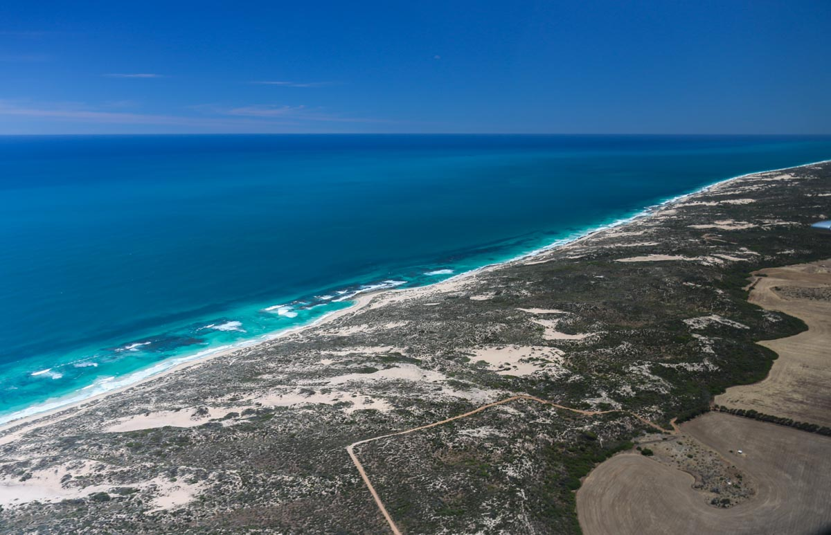Beaches 3km SSW of Greenough, seen from VH-ICE Cirrus SR22 GTS G5 (MSN 4063) owned by Andrew Dean - Sat 15 November 2014. View facing northwest. Photo © David Eyre