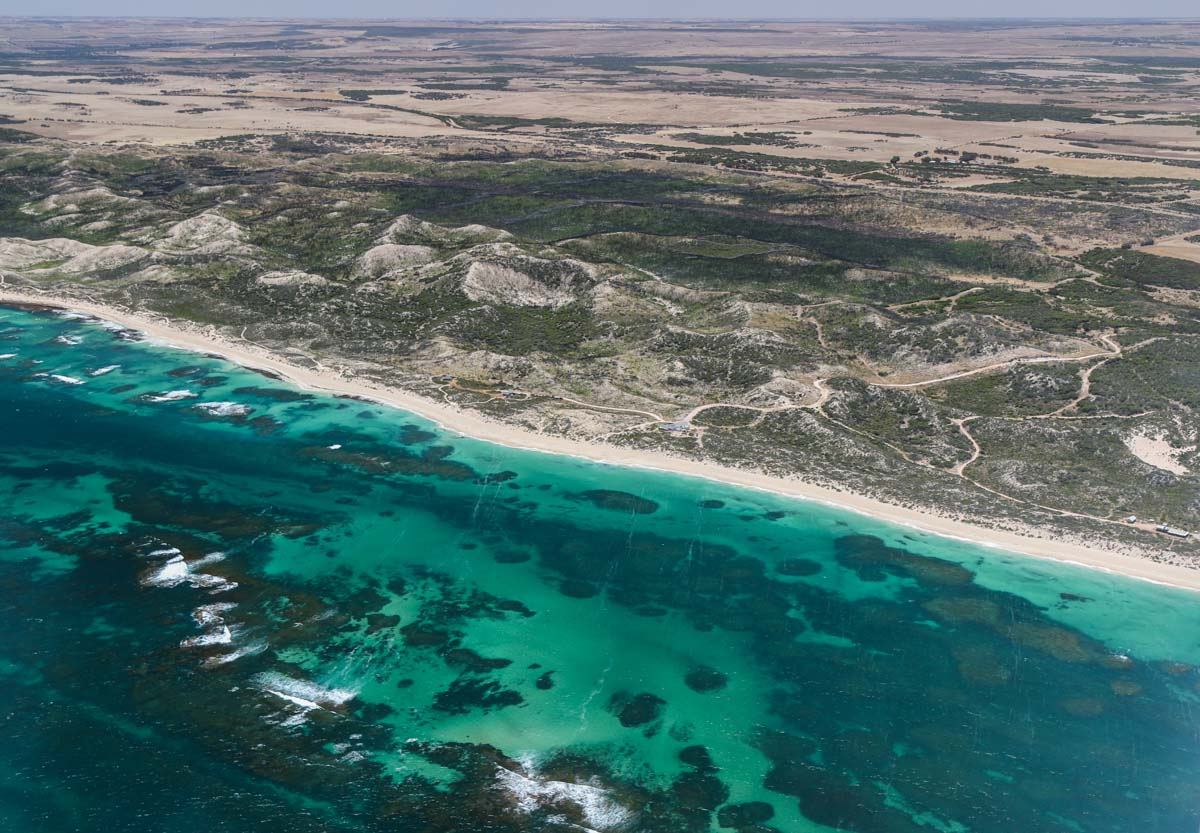 Beach at Bookara, seen from VH-ICE Cirrus SR22 GTS G5 (MSN 4063) owned by Andrew Dean - Sat 15 November 2014. View facing east. 13km north of Dongara. Photo © David Eyre
