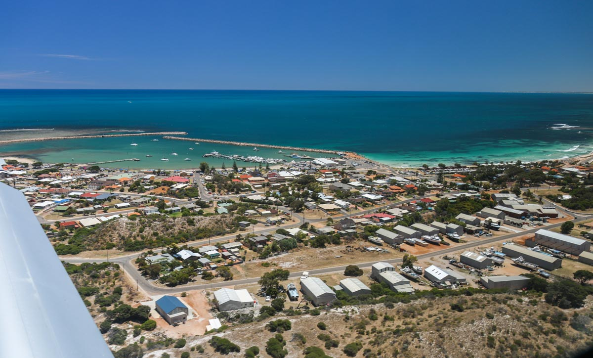 Port Denison, Dongara, seen from VH-ICE Cirrus SR22 GTS G5 (MSN 4063) owned by Andrew Dean - Sat 15 November 2014. View facing west. Dongara/Port Denison is a cray fishing town, and numerous cray boats can be seen in the port and onshore. About to land on runway 18 at Dongara Airfield. Photo © David Eyre