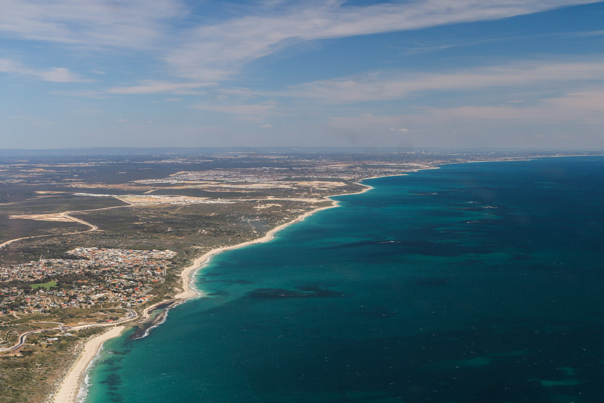 Coast from Yanchep to Hillarys Boat Harbour, seen from VH-ICE Cirrus SR22 GTS G5 (MSN 4063) owned by Andrew Dean - Sat 15 November 2014. View facing southeast. Yanchep on lower left. Perth city centre can be seen in the distance. Photo © David Eyre