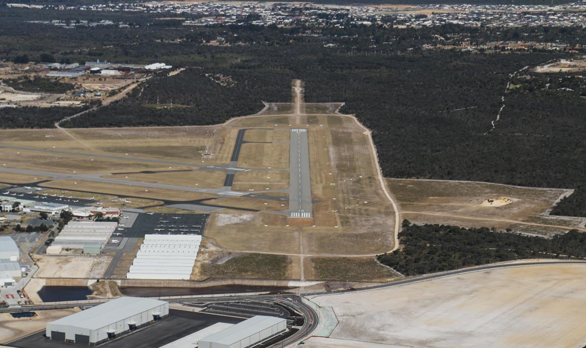 Jandakot Airport, seen from VH-ICE Cirrus SR22 GTS G5 (MSN 4063) owned by Andrew Dean - Sat 15 November 2014. View facing southeast along runway 12, as we entered the downwind leg for runway 24R. Photo © David Eyre