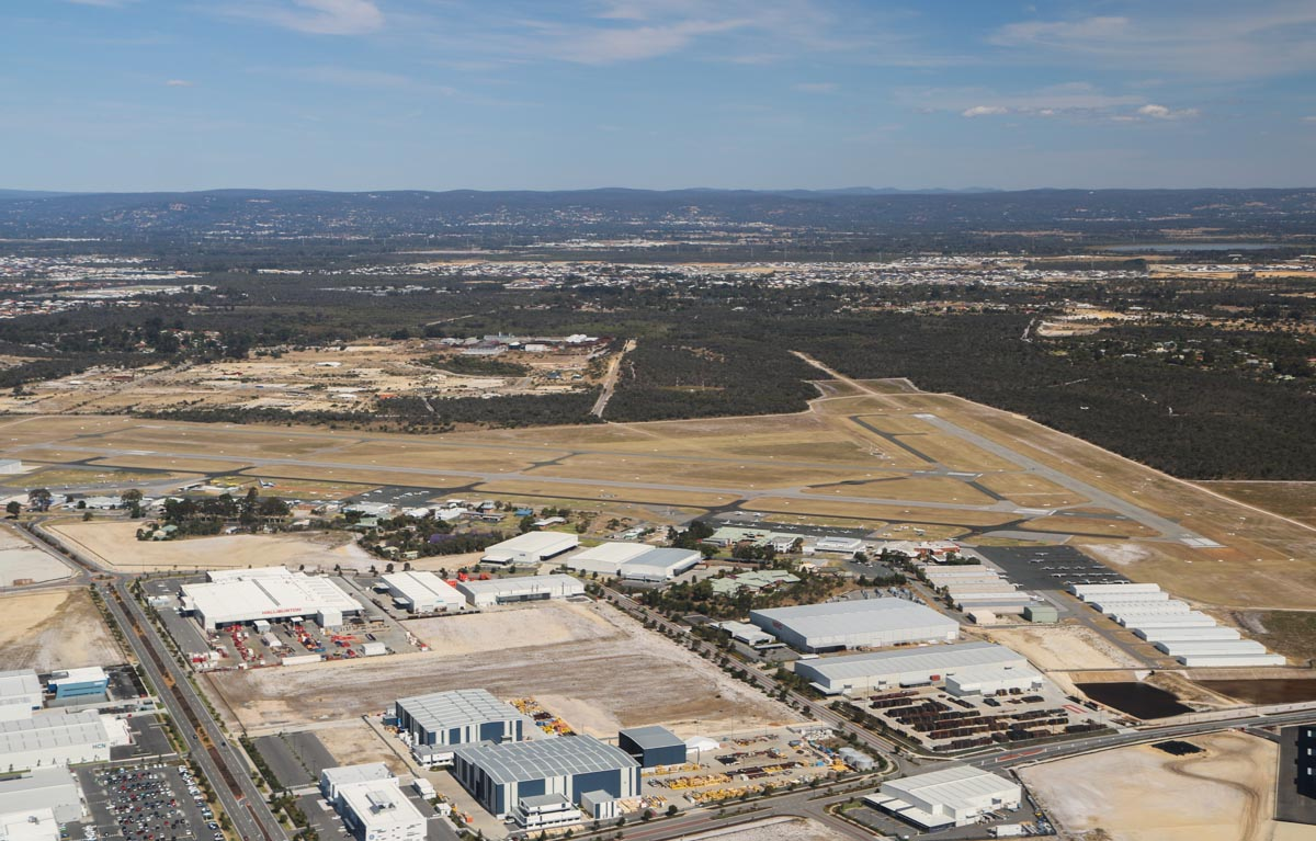 Jandakot Airport, seen from VH-ICE Cirrus SR22 GTS G5 (MSN 4063) owned by Andrew Dean - Sat 15 November 2014. View facing southeast, as we flew the downwind leg for runway 24R (running left to right across the photo. Photo © David Eyre
