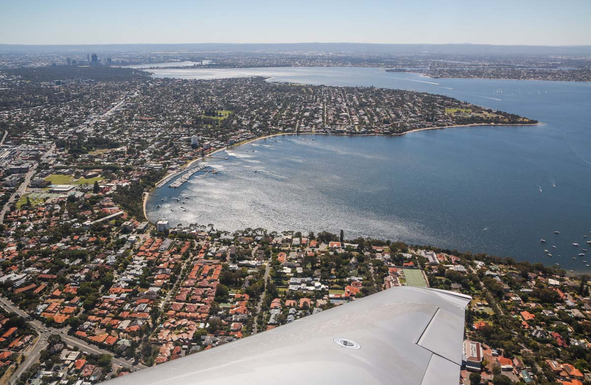 Claremont and Dalkeith, with Perth city in the distance, seen from VH-ICE Cirrus SR22 GTS G5 (MSN 4063) owned by Andrew Dean - Sat 15 November 2014. View facing east on a flight from Jandakot to Geraldton, Dongara and back. Photo © David Eyre