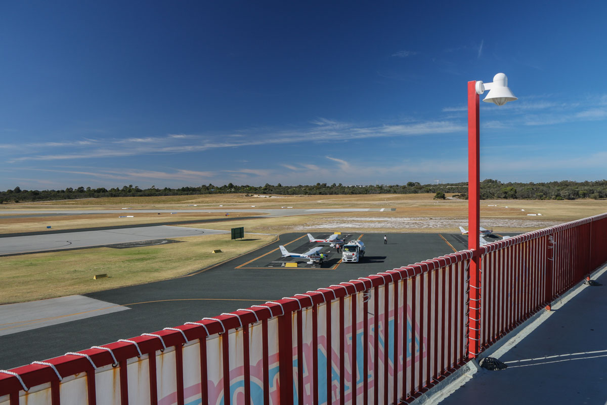 Royal Aero Club of Western Australia building, top floor viewing area, facing south. Morning photo. Runway 12 threshold visible at centre, runway 06L threshold at centre left. Jandakot Airport - Sat 15 November 2014 Photo © David Eyre