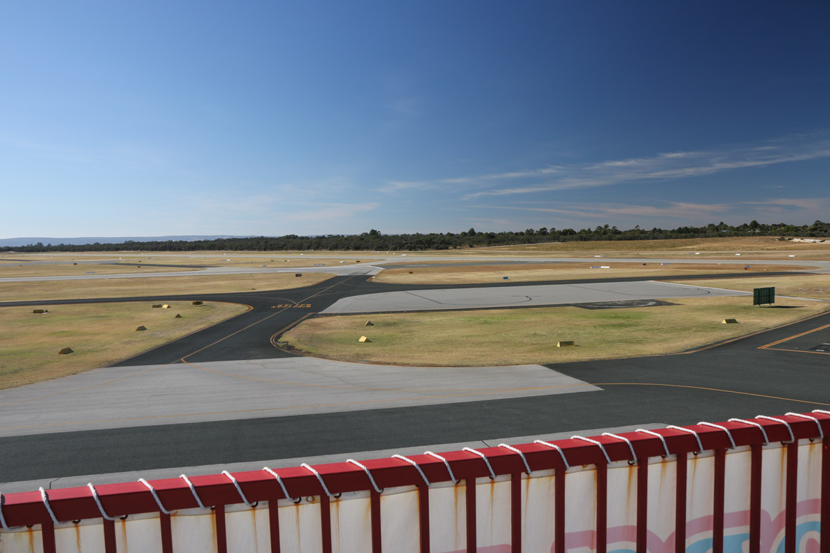 Royal Aero Club of Western Australia building, top floor viewing area, facing southeast. Morning photo. Runway 12 threshold visible at centre right, runway 06L threshold at centre. Jandakot Airport - Sat 15 November 2014. Photo © David Eyre