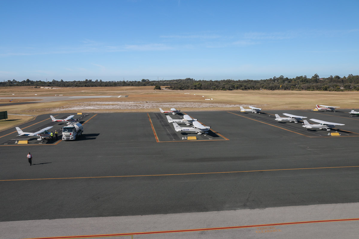 View southwest from Royal Aero Club of Western Australia building, top floor viewing area. Morning photo using 17-55mm wide angle zoom lens. Royal Aero Club apron and Runway 12 threshold visible. Jandakot Airport - Sat 15 November 2014. Photo © David Eyre