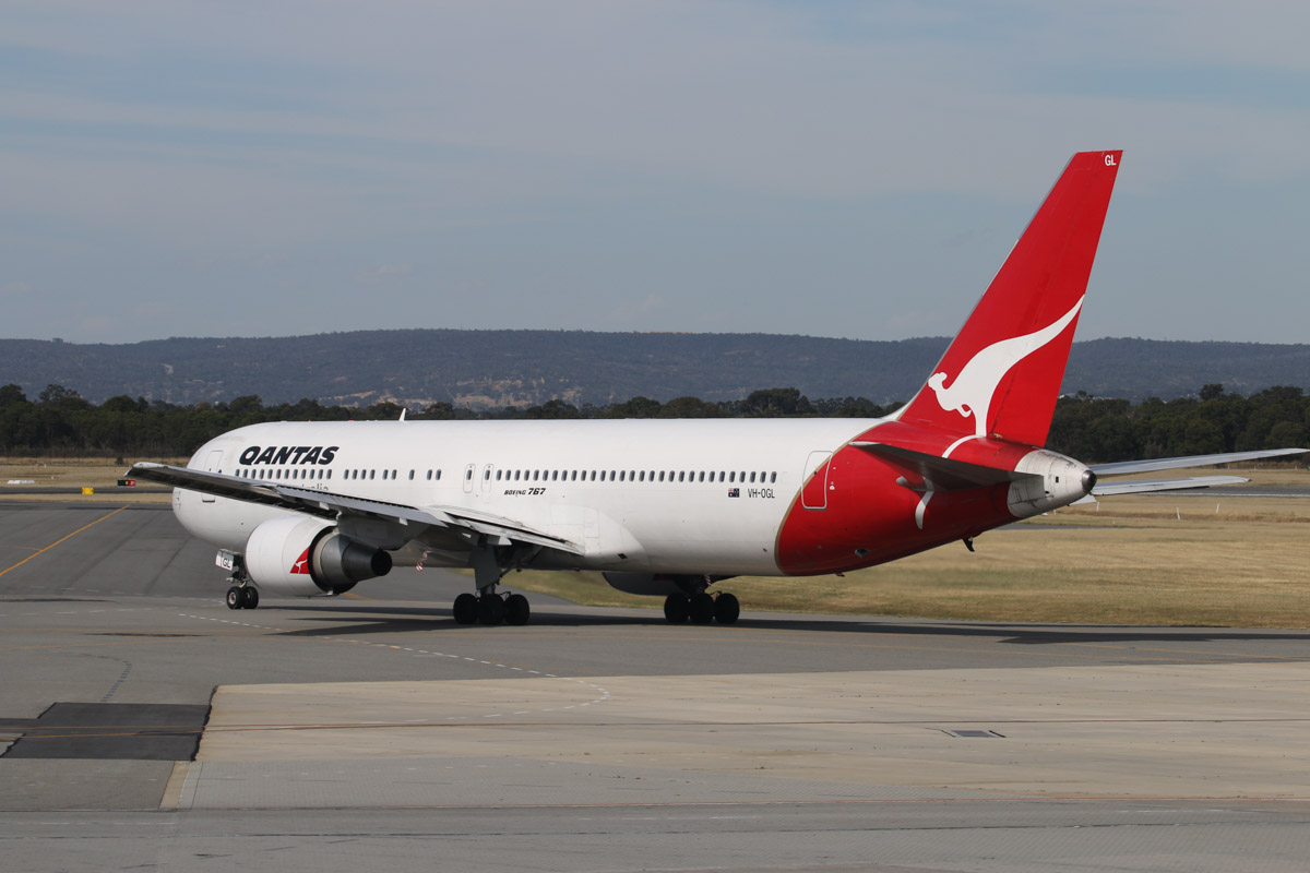 VH-OGL Boeing 767-338ER (MSN 25363/402) of Qantas at Perth Airport - Mon 17 November 2014. This was meant to be the final Qantas 767 visit to Perth; aircrew took photos in front of it during turnaround and the fire fighters gave it a water cannon salute as it left, but there were six more visits after this one. However, this was the final visit to Perth by VH-OGL, which also performed the final Qantas 767 service, from Melbourne to Sydney on 27 December 2014. It arrived as QF651 from Brisbane at 2:23pm. It is seen here departing as QF718 to Canberra at 3:43pm. Photo © David Eyre