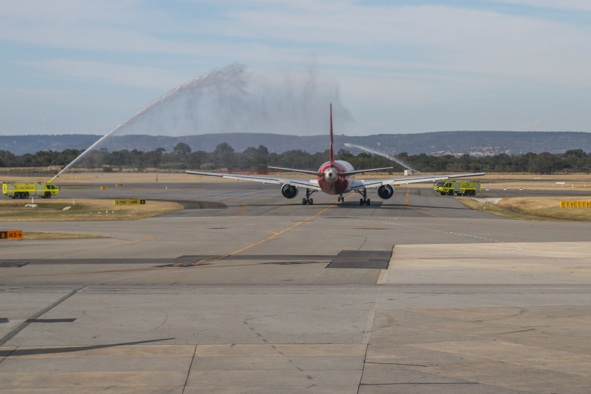 VH-OGL Boeing 767-338ER (MSN 25363/402) of Qantas at Perth Airport - Mon 17 November 2014. This was meant to be the final Qantas 767 visit to Perth; aircrew took photos in front of it during turnaround and the fire fighters gave it a water cannon salute as it left, but there were six more visits after this one. However, this was the final visit to Perth by VH-OGL, which also performed the final Qantas 767 service, from Melbourne to Sydney on 27 December 2014. It arrived as QF651 from Brisbane at 2:23pm. It is seen here departing as QF718 to Canberra at 3:43pm. The water cannon salute didn't go quite as planned, perhaps due to the right hand fire truck being too close to the aircraft - he turned off the water cannon before the aircraft got near to him. Photo © David Eyre