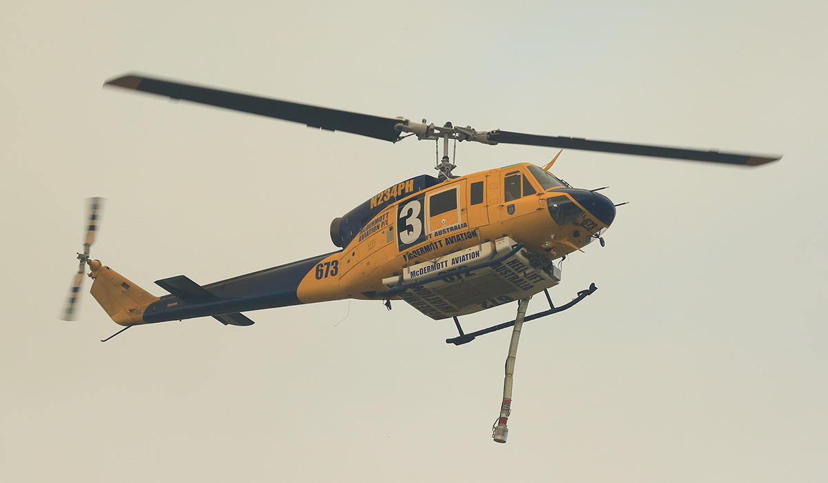 Helitacs filling their water tanks to fight the fire in Whiteman Park