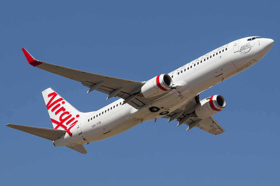"VH-YIB Boeing 737-8FE (cn 37825/3758) of Virgin Australia, which is named ""Trinity Beach"" at Perth Airport – Fri 19 Dec 2014.   Taking off on runway 21 at 2:47 pm. Photo © Evan Robson."