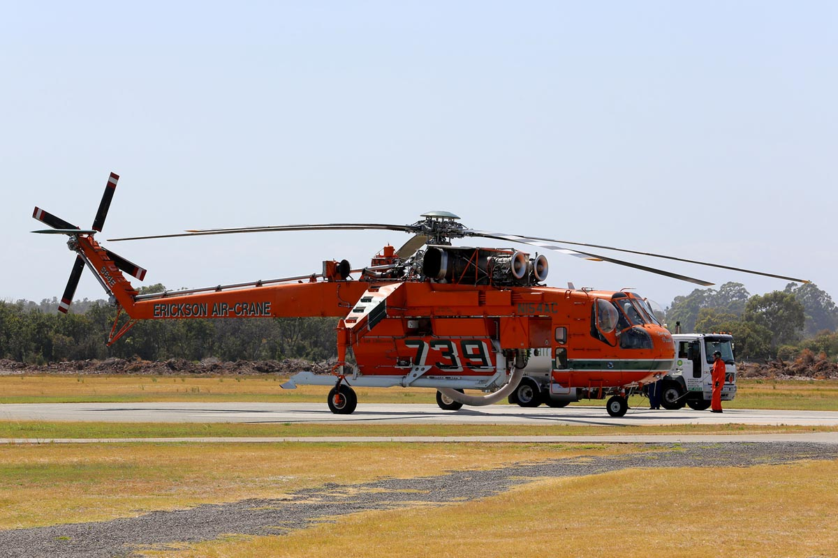 N154AC Sikorsky S-64E Skycrane (MSN 64-037), named 'Georgia Peach', of Erickson Air-Crane at Jandakot Airport – Sat 20 December 2014. Seen refuelling, shortly after arriving from Fremantle Port, having arrived by sea. It departed at 9:44am to Serpentine Airfield, where it will be based. Under contract to the WA Government on firefighting duties for the 2014/2015 season. Built in 1967. Delivered to the US Army in February 1968 as 68-18435, as a CH-54A Tarhe. Last served with 1160 Aviation Company, Georgia Army National Guard. Retired from military service in late 1980s. On 26 March 1992, registered to Erickson Air Crane Co, Central Point, Oregon, USA as N154AC. Photo © Matt Hayes