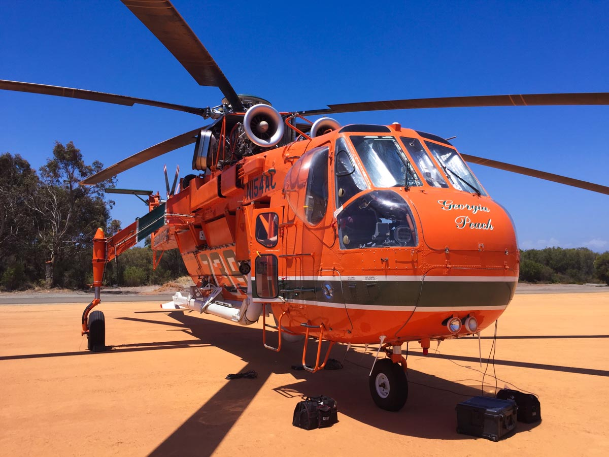 N154AC Sikorsky S-64E Skycrane (MSN 64-037), named 'Georgia Peach', of Erickson Air-Crane at Serpentine Airfield – Sat 20 December 2014. Seen shortly after arriving at Serpentine from Fremantle Port via Jandakot. Under contract to the WA Government on firefighting duties for the 2014/2015 season. Built in 1967. Delivered to the US Army in February 1968 as 68-18435, as a CH-54A Tarhe. Last served with 1160 Aviation Company, Georgia Army National Guard. Retired from military service in late 1980s. On 26 March 1992, registered to Erickson Air Crane Co, Central Point, Oregon, USA as N154AC. Photo © Scott Palmer