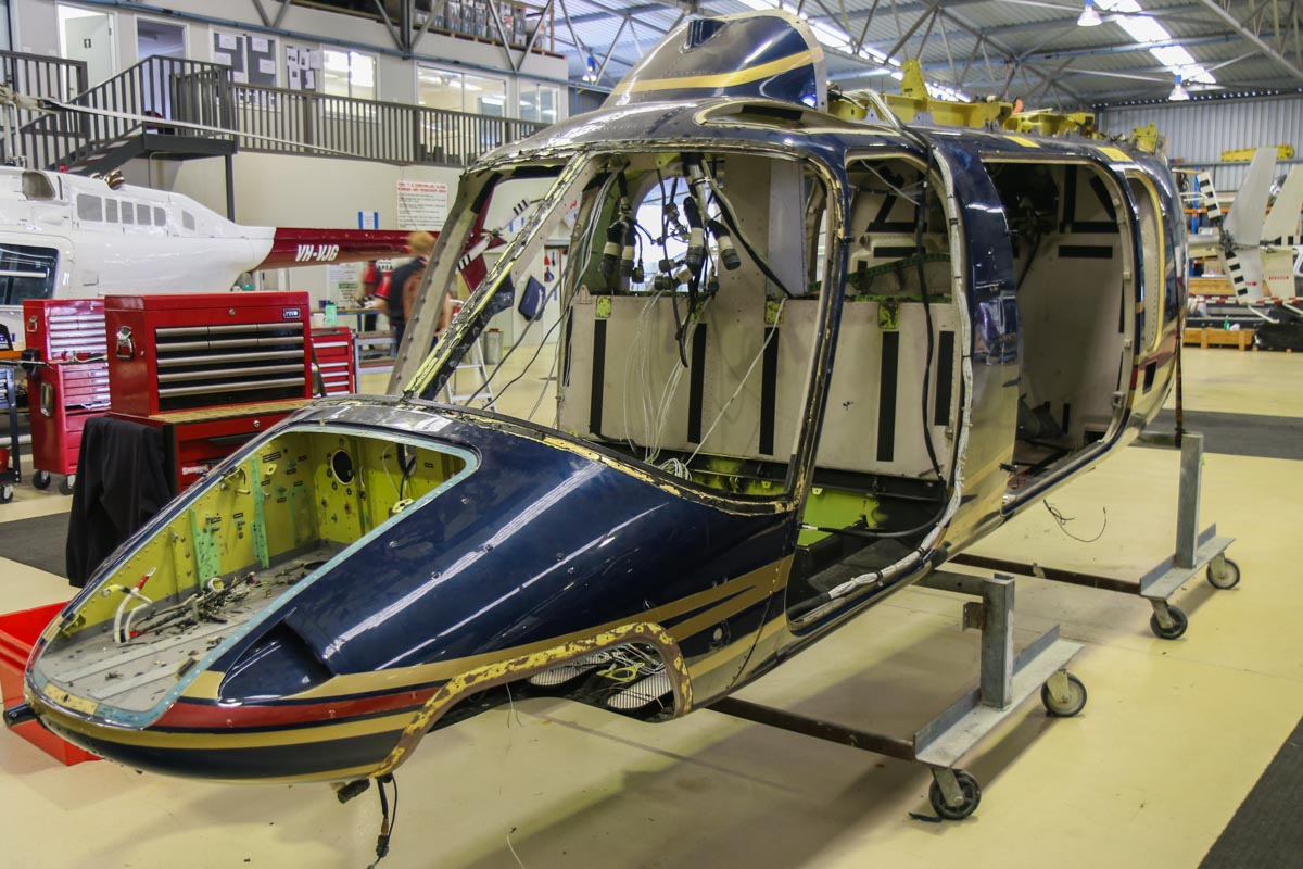 N427AL Bell 427 (MSN 56018) owned by Heliwest, at Jandakot Airport - Fri 28 November 2014. Inside the Heliwest hangar. N427AL was formerly owned by Southern Aviation Systems LLC, Florida, USA. It was written off on 4 June 2012 near Indiantown, Florida. On a flight from Palm Beach to Ocala, the helicopter had to maneuver to avoid some large Black Vulture birds, but one hit near the main rotor mast area, damaging a pitch change link. The helicopter began shaking violently and became difficult to control, so the pilot executed an emergency landing. Control was lost during the landing and the helicopter spun around, hit the ground and rolled overonto the left side. The main and tail rotor systems and the fuselage sustained substantial damage. Both pitch change rods with bird remains were separated from one of their attach points. Black Vulture DNA identified. The written-off fuselage was then purchased by Heliwest as a source of spare parts for their Bell 427, VH-XSQ. Photo © David Eyre