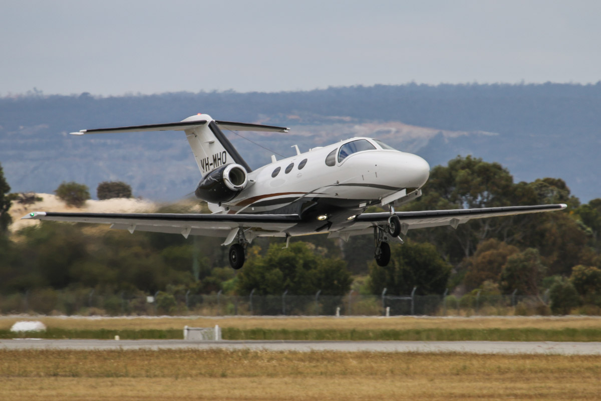 VH-MHO Cessna 510 Citation Mustang (MSN 510-0363) owned by Tadmar Investments Pty Ltd, at Jandakot Airport - Fri 28 November 2014. Built in 2011, ex N363MU. Taking off runway 24R at 3:10pm, for a short flight to Busselton and back. Photo © David Eyre