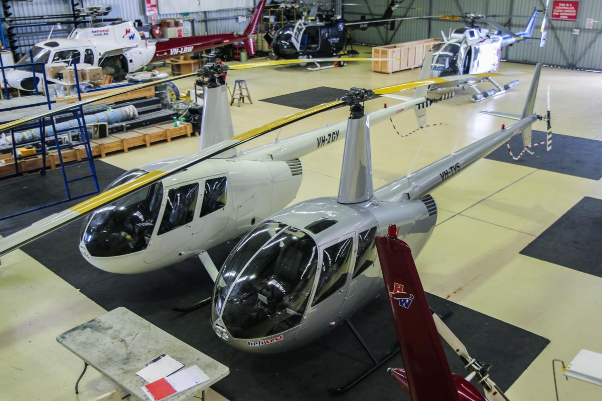 VH-ZGY (MSN 12491) and VH-TVS (MSN 11833) Robinson R44 Raven II of Heliwest, at Jandakot Airport - Fri 28 November 2014. Inside the Heliwest hangar. Photo © David Eyre