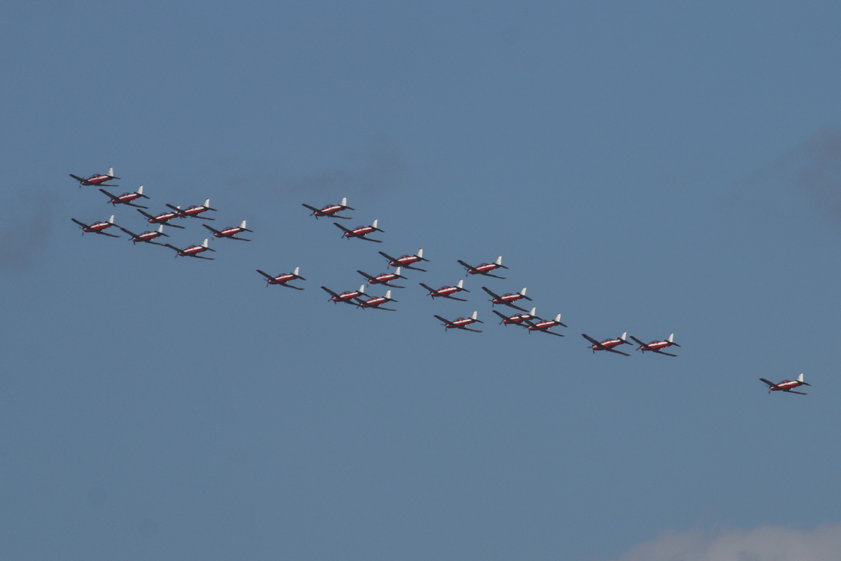 24 Pilatus PC-9/A aircraft of 2 Flying Training School (2FTS), RAAF, based at Pearce, WA, in Thunderbird formation over the northern suburbs of Perth – Wed 3 December 2014. The chase plane is at extreme right. The 'Thunderbird' formation was a salute to six Royal Australian Air Force (RAAF) students and one Royal Australian Navy (RAN) student of number 237 Pilots Course who graduated as military aviators in a ceremony held the next day, on Thursday 4 December 2014 at RAAF Base Pearce, after their 38-week course with 2 Flying Training School (2FTS). The Thunderbird formation is also treated as a training activity for the student pilots. After taking off from RAAF Pearce, they gathered into their formation west of Gingin, then headed south west to pass over Rottnest Island at approximately 3.54pm, over Fremantle at approximately 3.57pm, then up the Swan River to pass in front of Perth city at approximately 4.00pm. They are seen here over the north eastern suburbs at 4.10pm before passing over RAAF Pearce for a flypast at 4:12pm. Photo © David Eyre