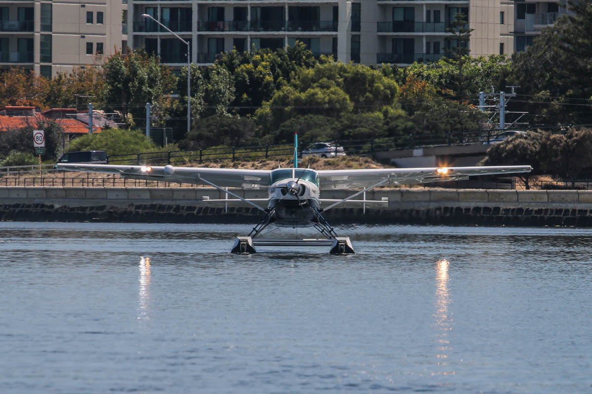 VH-OPH Cessna 208 Caravan floatplane (MSN 20800157) of Catalina Airlines, on the Swan River at Melville Water, near South Perth – Wed 3 December 2014. Lined up on the seaplane 'runway' about to take off at 9:55am, after a test landing on the Swan River, west of Millpoint Road, South Perth. Catalina Adventures expect to start seaplane tours from February 2015. Photo © David Eyre