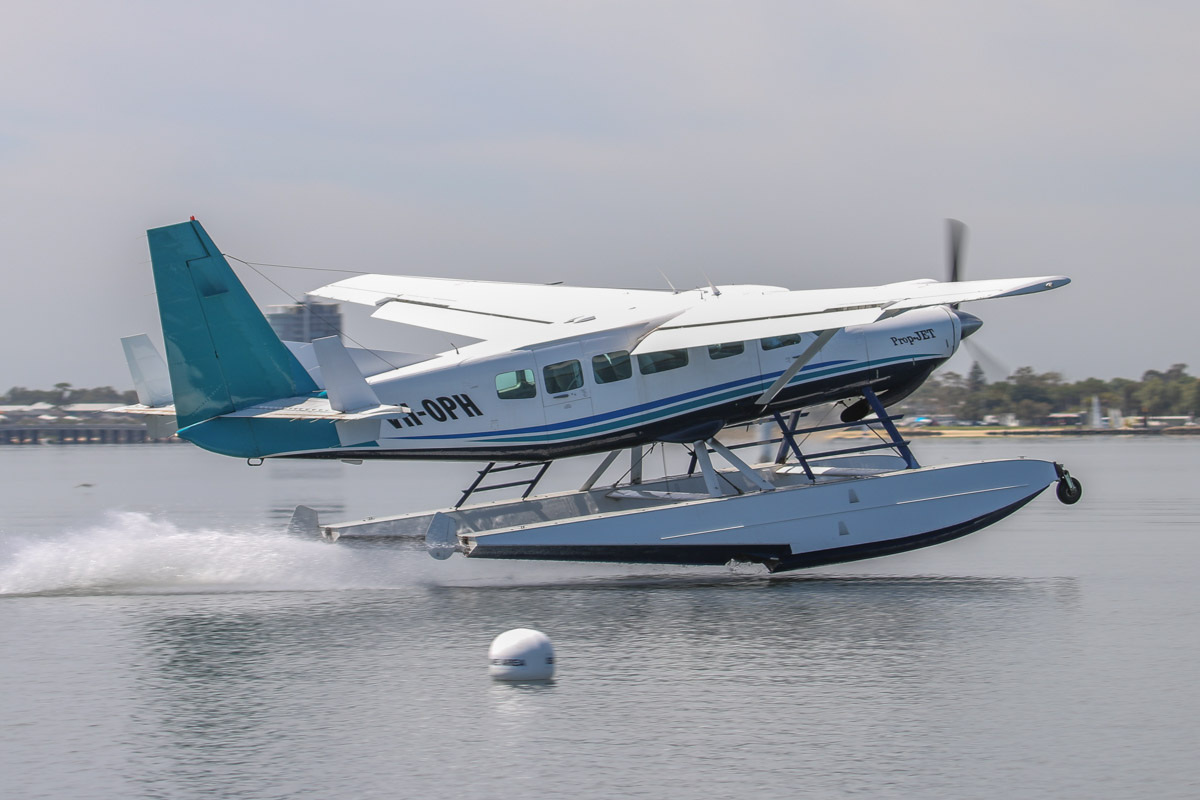 VH-OPH Cessna 208 Caravan floatplane (MSN 20800157) of Catalina Airlines, on the Swan River at Melville Water, near South Perth – Wed 3 December 2014. Taking off at 9:55am, after a test landing on the Swan River, west of Millpoint Road, South Perth. Catalina Adventures expect to start seaplane tours from February 2015. Photo © David Eyre