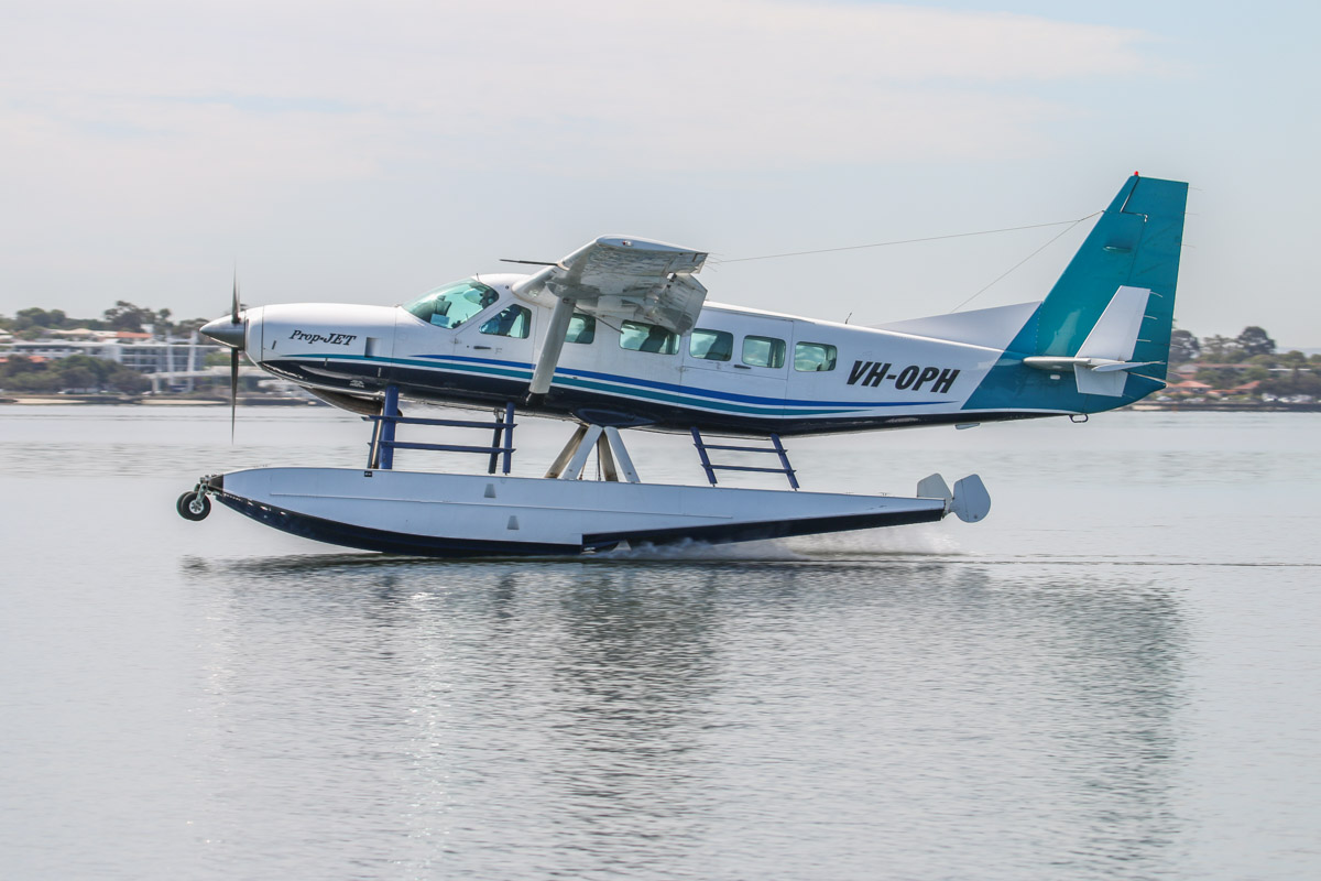 VH-OPH Cessna 208 Caravan floatplane (MSN 20800157) of Catalina Airlines, on the Swan River at Melville Water, near South Perth – Wed 3 December 2014. A test landing on the Swan River at 9:26am, west of Millpoint Road, South Perth. Catalina Adventures expect to start seaplane tours from February 2015 with this 13-seat Cessna Caravan. Photo © David Eyre