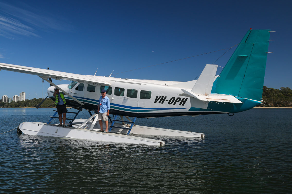 VH-OPH Cessna 208 Caravan floatplane (MSN 20800157) of Catalina Airlines, on the Swan River at Melville Water, near South Perth – Wed 3 December 2014. Moored after a test landing on the Swan River at 9:26am, west of Millpoint Road, South Perth. Catalina Adventures expect to start seaplane tours from February 2015 with this 13-seat Cessna Caravan. On the left is Catalina Adventures owner Mack McCormack, with pilot Lynden Williams (formerly with Qantas) next to him. Photo © David Eyre