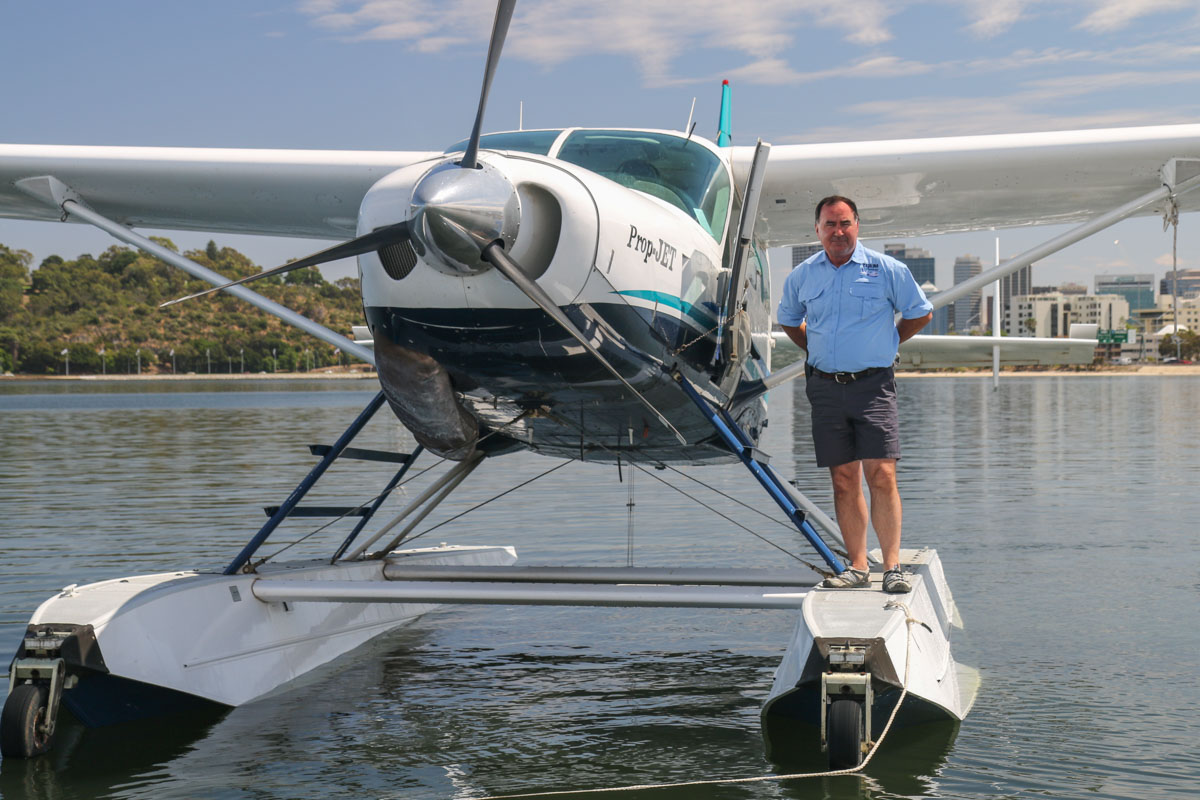 VH-OPH Cessna 208 Caravan floatplane (MSN 20800157) of Catalina Airlines, on the Swan River at Melville Water, near South Perth – Wed 3 December 2014. Catalina Adventures owner, Mack McCormack standing on the float of VH-OPH shortly before it departed after a test landing on the Swan River, west of Millpoint Road, South Perth. Catalina Adventures expect to start seaplane tours from February 2015. Photo © David Eyre