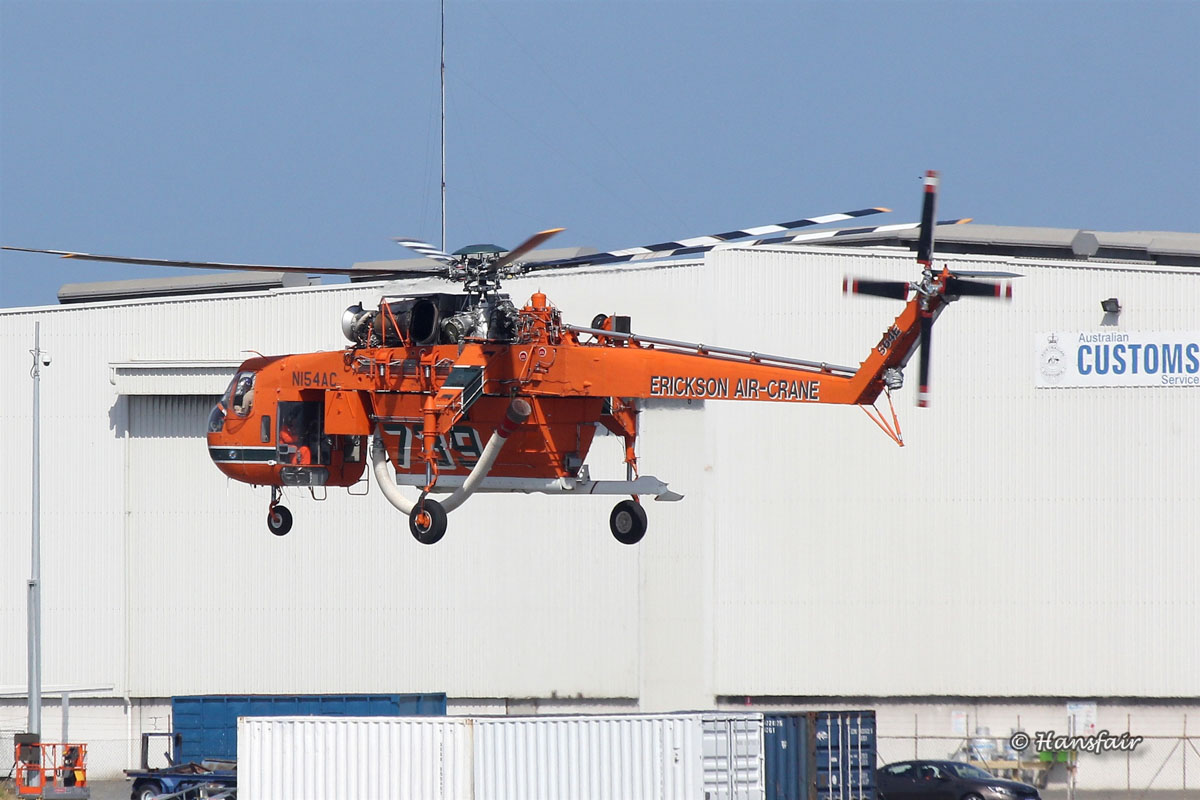 N154AC Sikorsky S-64E Skycrane (MSN 64-037), named 'Georgia Peach', of Erickson Air-Crane at North Quay, Fremantle Port – Sat 20 December 2014. Seen taking-off from Number 1 Berth at North Quay, Fremantle, to fly to Jandakot for refuelling. It departed Jandakot at 9:44am to Serpentine Airfield, where it will be based. Under contract to the WA Government on firefighting duties for the 2014/2015 season. Built in 1967. Delivered to the US Army in February 1968 as 68-18435, as a CH-54A Tarhe. Last served with 1160 Aviation Company, Georgia Army National Guard. Retired from military service in late 1980s. On 26 March 1992, registered to Erickson Air Crane Co, Central Point, Oregon, USA as N154AC. Photo © Hans Fairhurst - used with permission.