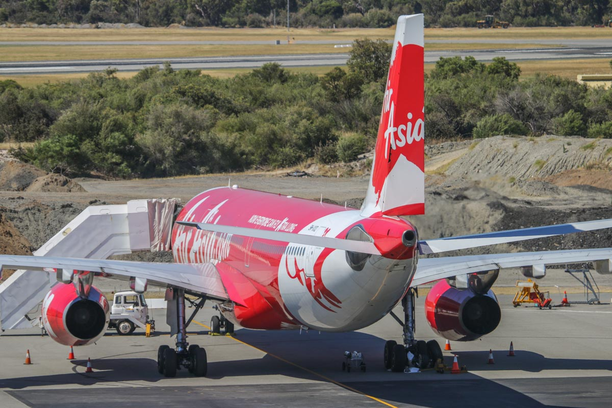 9M-XXD Airbus A330-343X (MSN 1066), named 'Soaring Xpectations' of AirAsia X at Perth Airport – Sun 28 December 2014. This aircraft blew a tyre while landing as flight D7236 from Kuala Lumpur at 5:48am today. This also caused a hydraulic leak and the aircraft taxied off the runway at taxiway L2 and parked on the taxiway. Passengers had to wait aboard, until buses could take them to the terminal. The aircraft was then towed to Bay 60 and the blown tyre was removed, as seen here. Spare parts were flown in aboard the afternoon D7232 flight, and 9M-XXD finally departed as flight D7237D at 10.14pm the next day (29 December). Photo © David Eyre