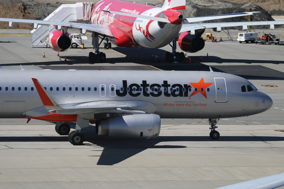 VH-VFN Airbus A320-232 sharklets (MSN 5566) of Jetstar at Perth Airport – Sun 28 December 2014. This aircraft formerly wore a special livery 'Celebrating 100 Aircraft and over 100 Million Passengers', from delivery in 2013, until it was removed in late 2014. Flight JQ109 from Denpasar (Bali), taxying in to park at Bay 56 at 3:30pm. In the background is 9M-XXD Airbus A330-343 (MSN 1066), named 'Soaring Xpectations' of Air Asia X, which blew a tyre while landing as flight D7236 from Kuala Lumpur at 5:48am today. This also caused a hydraulic leak and the aircraft taxied off the runway at taxiway L2 and passengers had to wait aboard until buses could take them to the terminal. The aircraft was then towed to Bay 60 and the blown tyre was removed, as seen here. Spare parts were flown in aboard the afternoon D7232 flight, and 9M-XXD finally departed as flight D7237D at 10.14pm the next day (29 December). Photo © David Eyre