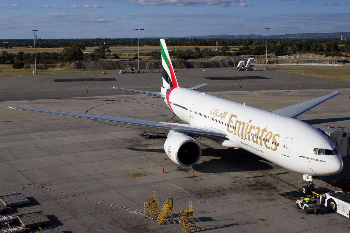 A6-EWC Boeing 777-21H LR (MSN 35576/677) of Emirates, at Perth Airport – Mon 2 March 2015. Flight EK423 to Dubai, parked at Bay 54 at 5:07pm, prior to departure. Photo © Evan Robson