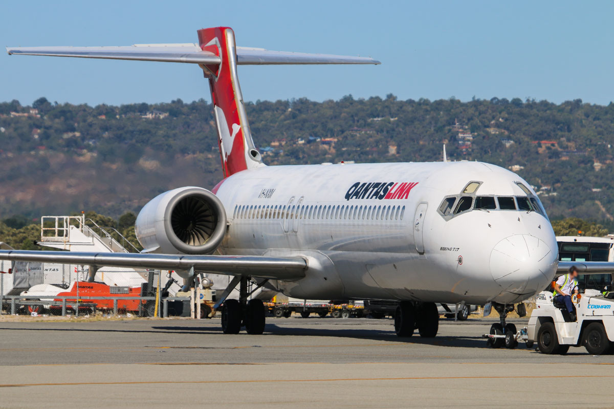 VH-NXM Boeing 717-231 (MSN 55094/5084) of QantasLink, at Perth Airport – Fri 6 March 2015. Being towed towards Terminal 4. Photo © David Eyre
