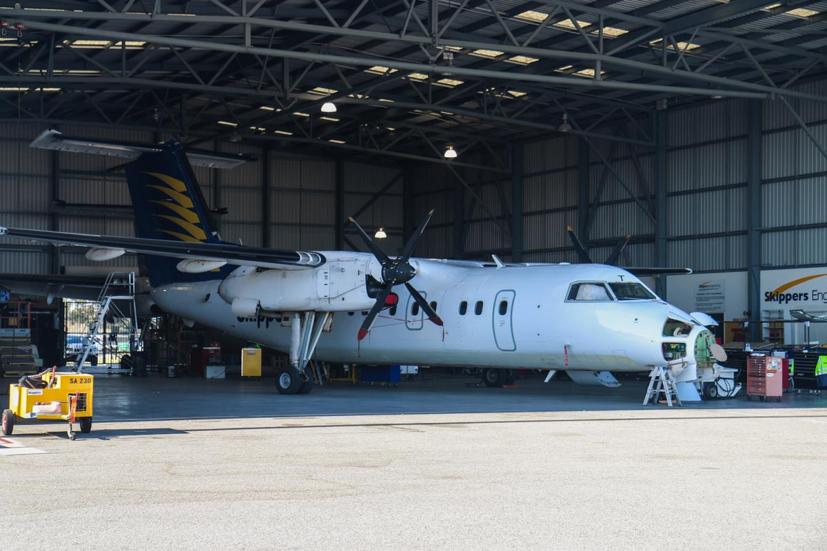 VH-XFT De Havilland Canada DHC-8-102 Dash 8 (MSN 052) of Skippers Aviation, at Perth Airport - Fri 6 March 2015. Inside one of the Skippers Aviation hangars, on the northwest part of Perth Airport. Photo © David Eyre