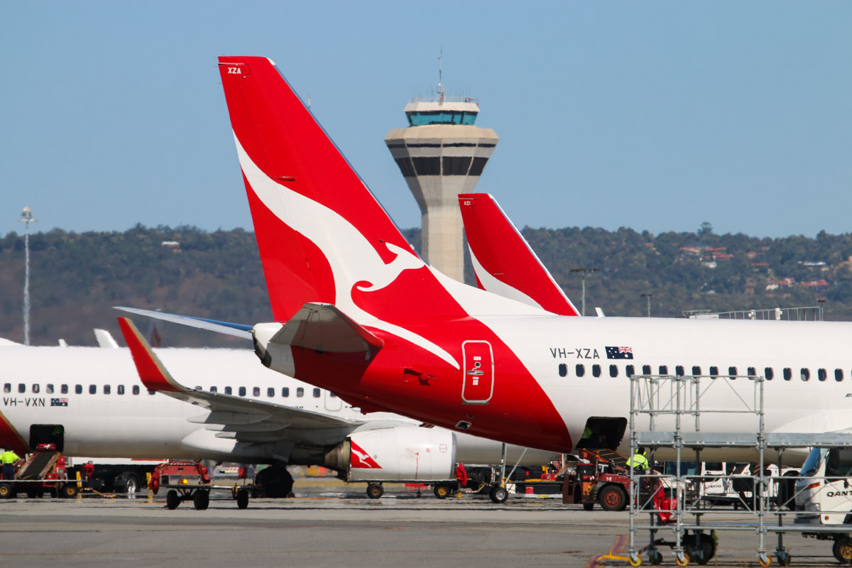 VH-XZA Boeing 737-838 (MSN 39367/4150) of Qantas, named 'Leeton', at Perth Airport - Fri 6 March 2015. Parked at Terminal 4. Behind are VH-VXN and VH-XZI, with the Control Tower in the distance. Photo © David Eyre