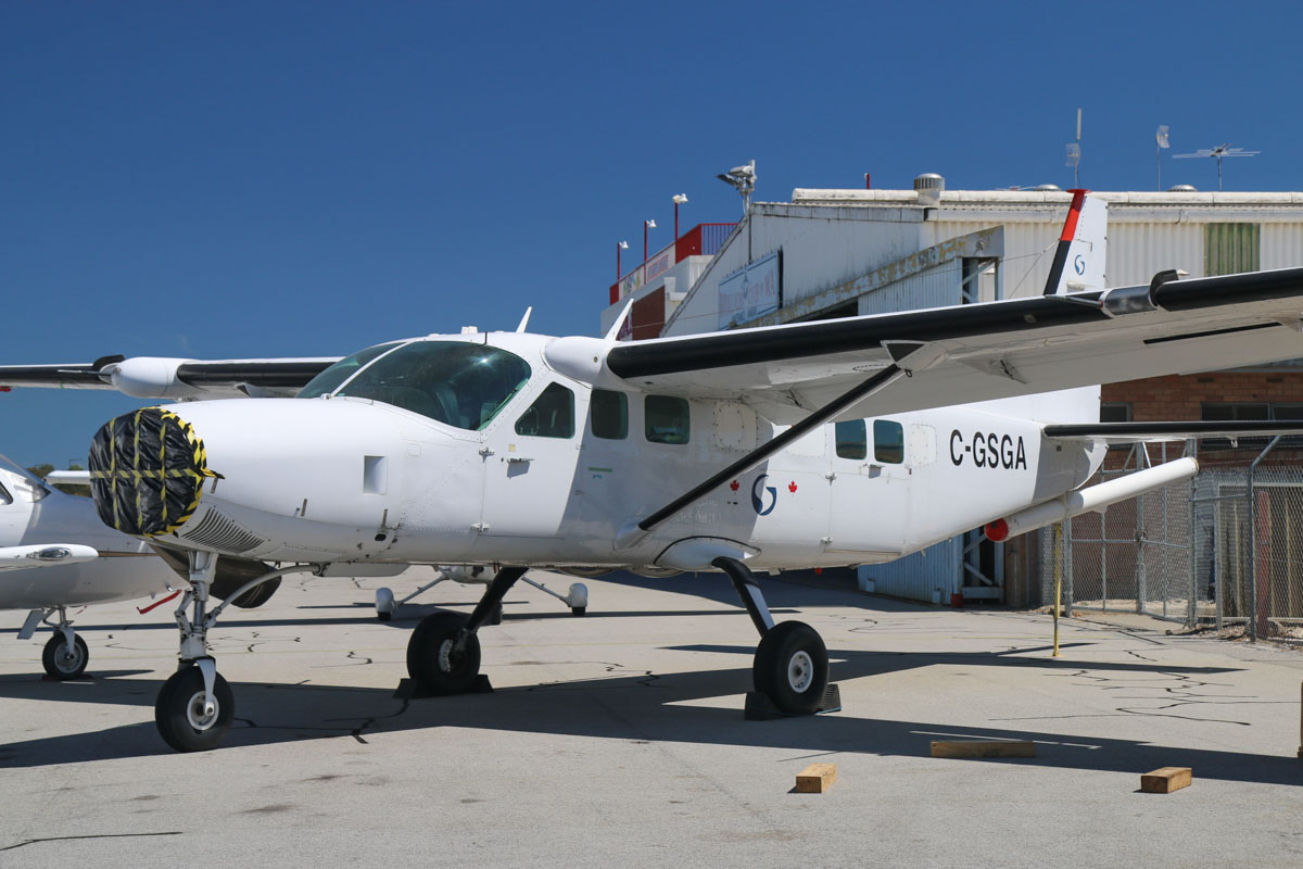 "C-GSGA Cessna 208B Grand Caravan (MSN 208B1228, ex N1084N), owned by Sander Geophysics Limited (Canada), at Jandakot Airport – Mon 9 March 2015. This aircraft has been at Jandakot for some time now. It flew Port Moresby (Papua New Guinea) to Cairns and Cloncurry in June 2014, before later arriving at Jandakot. It has been to Jandakot in the past, and has had its prop removed. the aircraft is used for geophysical surveys, detecting variations in the Earth's magnetic field caused by mineral bodies, using a magnetometer tail ""stinger"" boom. Photo © David Eyre"