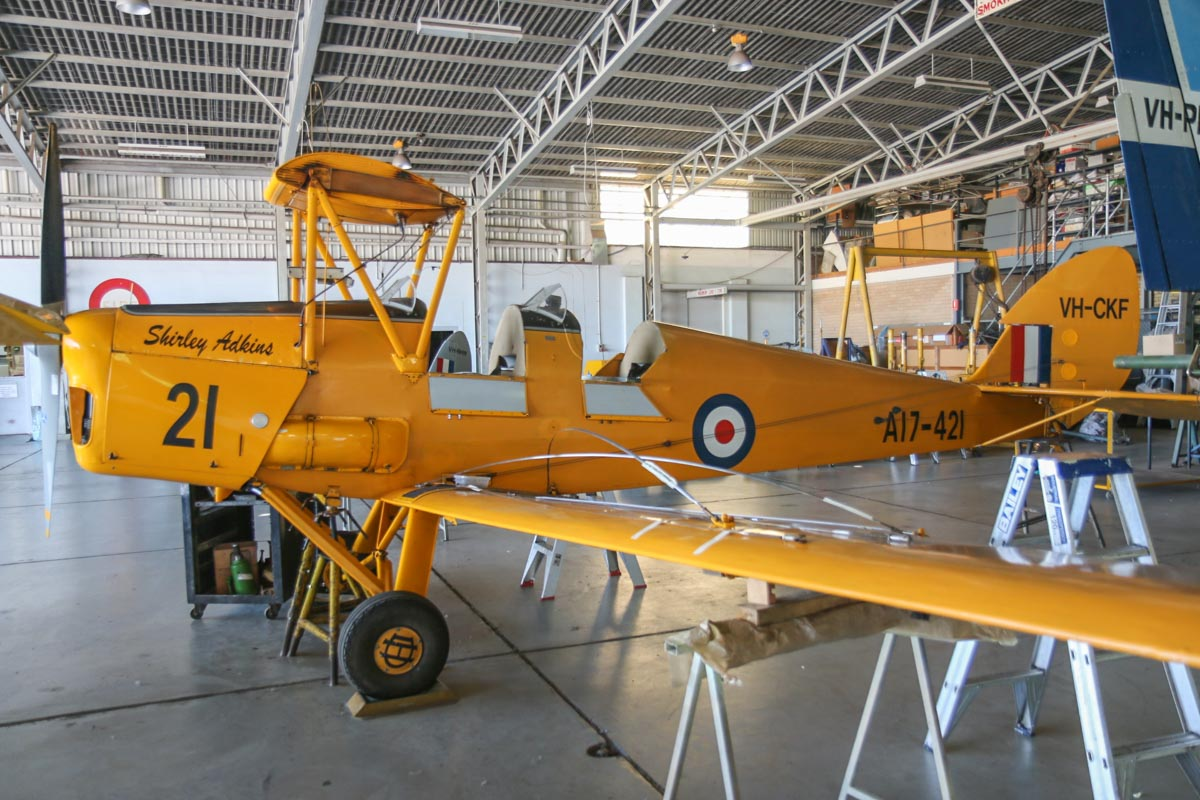 VH-CKF / A17-421 De Havilland DH-82A Tiger Moth (MSN DHA596/T200) of the Royal Aero Club of Western Australia Inc, named 'Shirley Adkins', at Jandakot Airport - Mon 9 March 2015. Undergoing major maintenance work. Built in 1941. Ordered for Rhodesia as DX535 but taken on RAAF charge on 4 October 1941 as A17-421. Acquired by Dept of Civil Aviation (DCA) from RAAF stock and converted for civil use with a raked-forward undercarriage which permitted the use of a tailwheel and wheel brakes. It was registered to DCA as VH-AZL on 26 June 1947. At the time of its initial conversion, or shortly afterwards, it was fitted with a canopy of a style developed by De Havilland Canada. Following a change of policy, it was re-registered in DCA's block as VH-CAG on 4 May 1949. It was allocated to DCA's Western Australia Region, based at Maylands. By 6 April 1957, the canopy had been removed, and the aircraft was used by DCA to test prospective aerial agriculture pilots. Sold to the Gliding Association of Western Australia on 5 April 1960 for £450. Reregistered 7.7.1960 as VH-TUG Gliding Association of Western Australia Inc, Doubleview, WA, later to Gliding Club of Western Australia Inc. , Bedford Park, WA. Reregistered 23.10.1965 as VH-CKF. Went through a number of owners before being sold in 1986 to Reg Adkins (ex MMA DC-3, F27 & F28 pilot). It was acquired by the Aero Club in December 2004. Photo © David Eyre