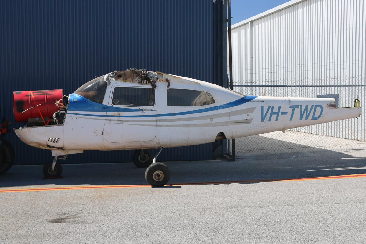 VH-TWD Cessna 210N Centurion (MSN 21064356) owned by Broome Air Services Pty Ltd, Broome, WA, at Jandakot Airport - Mon 9 March 2015. This aircraft is awaiting rebuild after an accident on 28 November 2014, 111 km SE of Halls Creek, WA. VH-TWD was enroute on a charter flight from Balgo Hills to Ringer Soak, when the pilot noticed a low oil pressure indication, followed by a burning smell in the cockpit, visible engine vibration and smoke. The pilot shut down the engine and configured the aircraft for a wheels up forced landing. The aircraft impacted the scrubby terrain hard and slid to a stop, suffering substantial damage. The passenger and pilot were unharmed and exited the aircraft. Photo © David Eyre