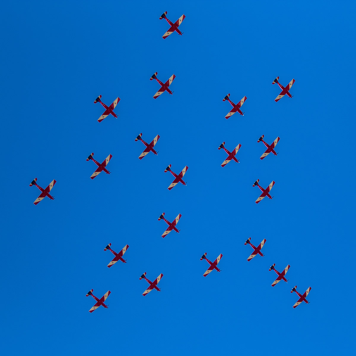 20 Pilatus PC-9/A aircraft of 2 Flying Training School (2FTS), RAAF, based at Pearce, WA, in Thunderbird formation over Monument Hill War Memorial, Fremantle – Thu 12 March 2015. The 'Thunderbird' formation was a salute to nine Australian Defence Force students of number 238 Pilots Course who graduated as military aviators in a ceremony held the next day, on Fri 13 March 2015 at RAAF Base Pearce, after their 38-week course with 2 Flying Training School (2FTS). The Thunderbird formation is also treated as a training activity for the student pilots. After taking off from RAAF Pearce, they gathered into their formation west of Gingin, then headed south west to pass over Rottnest Island, over Fremantle (as seen here after 4pm), then up the Swan River to pass in front of Perth city, before before passing over RAAF Pearce for a flypast and landing. Photo © Tim Grimes
