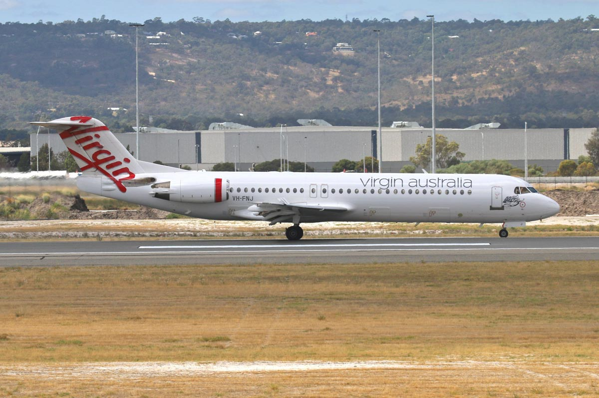 "VH-FNJ Fokker 100 (MSN 11489) of Virgin Australia Regional Airlines, named ""Talbot Bay"" at Perth Airport – Tue 17 March 2015. Aborted takeoff from runway 21 at 12.02pm. Photo © Steve Jaksic"