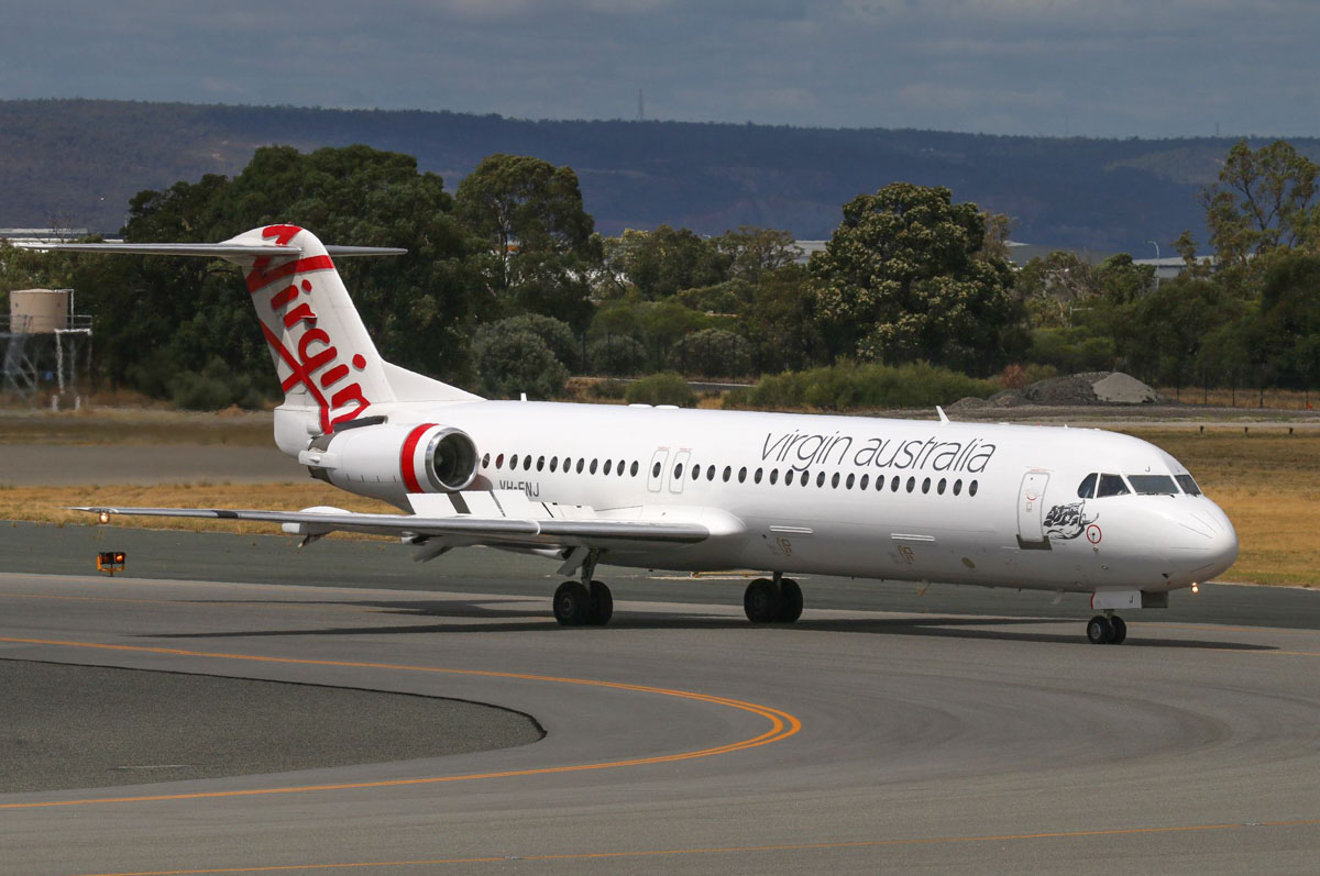 "VH-FNJ Fokker 100 (MSN 11489) of Virgin Australia Regional Airlines, named ""Talbot Bay"" at Perth Airport – Tue 17 March 2015. Taxying in at the far end of runway 21 at 12.02pm, after an aborted takeoff. Photo © Steve Jaksic"