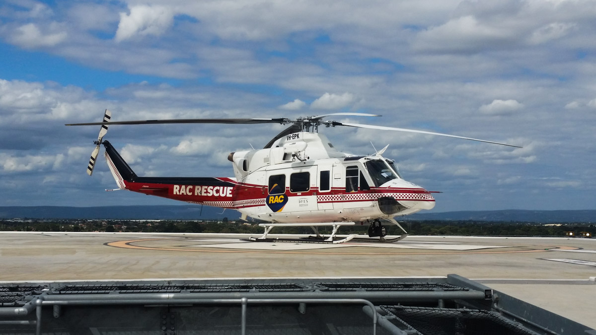 VH-EPK Bell 412EP (MSN 36100) of CHC Helicopters, on lease to the WA Department of Fire and Emergency Services as 'RAC RESCUE', at Fiona Stanley Hospital Helipad – Thu 19 March 2015. On 2 September 2013, VH-EPK was the first helicopter to perform a test landing on the helipad at the new $2 billion Fiona Stanley Hospital, before the hospital became operational.  The hospital recently became operational, but when VH-EPK was due to land there during an emergency airlift of two patients on 21 February 2015, the landing procedures for Fiona Stanley Hospital had not been finalised, so the helicopter had to divert to Jandakot.  This photo depicts what  may have been one of the first since the helipad became fully operational.  VH-EPK built in 1994. Ex C-GFNO, N68654, XC-JCU, N412HH. Photo © Christian Moore