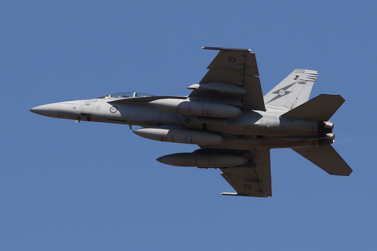 A44-209 Boeing F/A-18F Super Hornet (MSN AF-9, ex 167965) of 1 Squadron, RAAF at RAAF Base Pearce - Wed 1 April 2015. One of six Super Hornets returning home to RAAF Base Amberley in Queensland after completing seven months of air-strike operations against Islamic State militants in Iraq since September 2014. A44-209 has 20 combat mission markings painted on its nose. Photo © Matt Hannigan