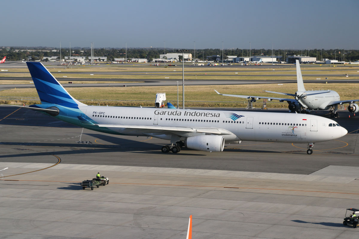 PK-GPC Airbus A330-341 (MSN 140) of Garuda Indonesia, at Perth Airport - Wed 1 April 2015. Flight GA727 to Denpasar (Bali), taxying out for departure at 7:47am. On the right is A39-005 Airbus KC-30A (A330-203MRTT) of 33 Squadron, RAAF. Photo © David Eyre