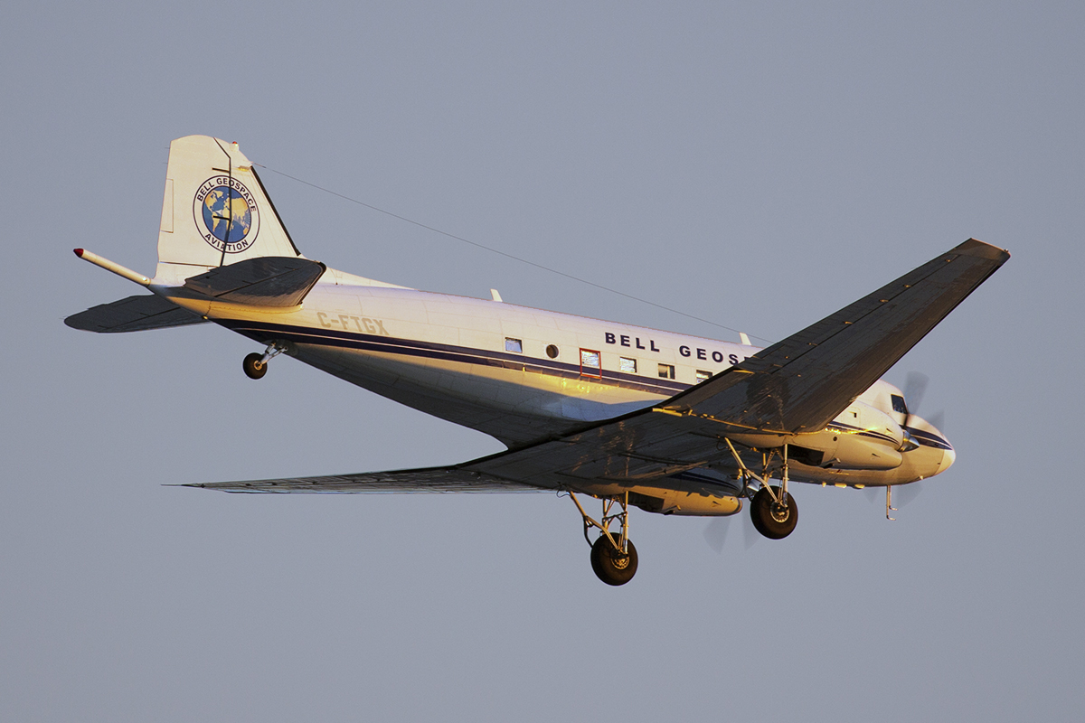 C-FTGX Douglas DC-3C (MSN 25769) of Bell Geospace at Perth Airport – 22 April 2015.On finals for runway 24 at 5:36 pm just as the sun was setting.