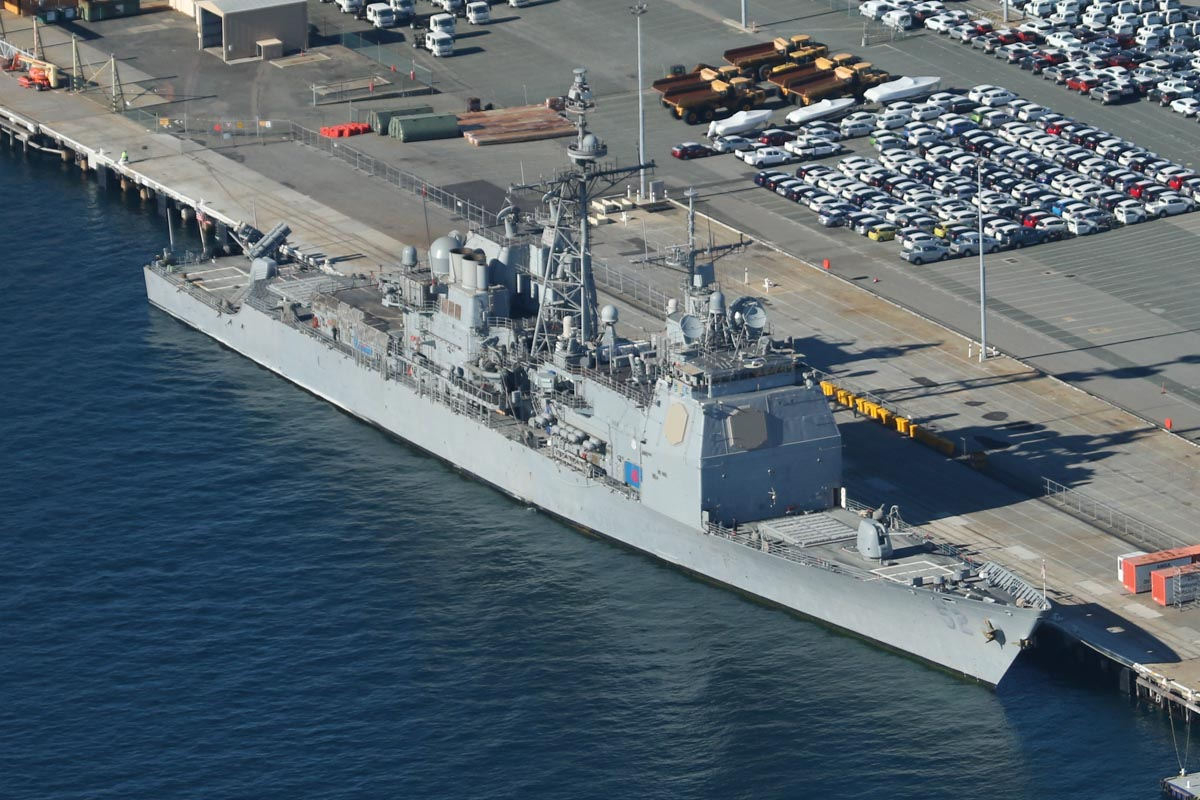 USS Bunker Hill (CG-52), a Ticonderoga-class guided missile cruiser, with a Sikorsky MH-60R Seahawk of HSM-73 Battle Cats on the flight deck, at Victoria Quay, Fremantle Port - Sun 26 April 2015. Arrived today on a rest and recreation visit before returning home to San Diego, after an eight-month deployment, including six months of combat operations in the Arabian Gulf as part of the aircraft carrier USS Carl Vinson's Strike Group. Photo © David Eyre