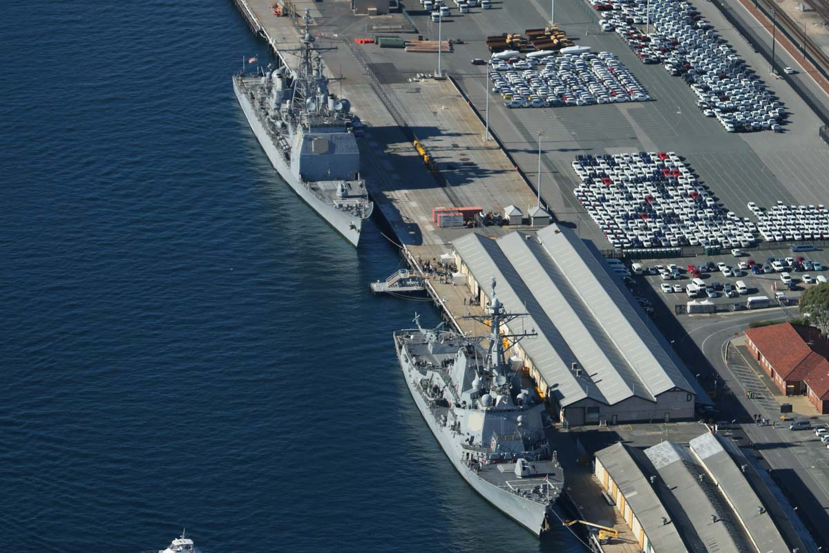 USS Bunker Hill (CG-52), a Ticonderoga-class guided missile cruiser, and USS Gridley (DDG-101), an Arleigh Burke-class guided missile destroyer, with a Sikorsky MH-60R Seahawk of HSM-73 Battle Cats on the flight deck, at Victoria Quay, Fremantle Port - Sun 26 April 2015. Arrived today on a rest and recreation visit before returning home to San Diego, after an eight-month deployment, including six months of combat operations in the Arabian Gulf as part of the aircraft carrier USS Carl Vinson's Strike Group. Photo © David Eyre