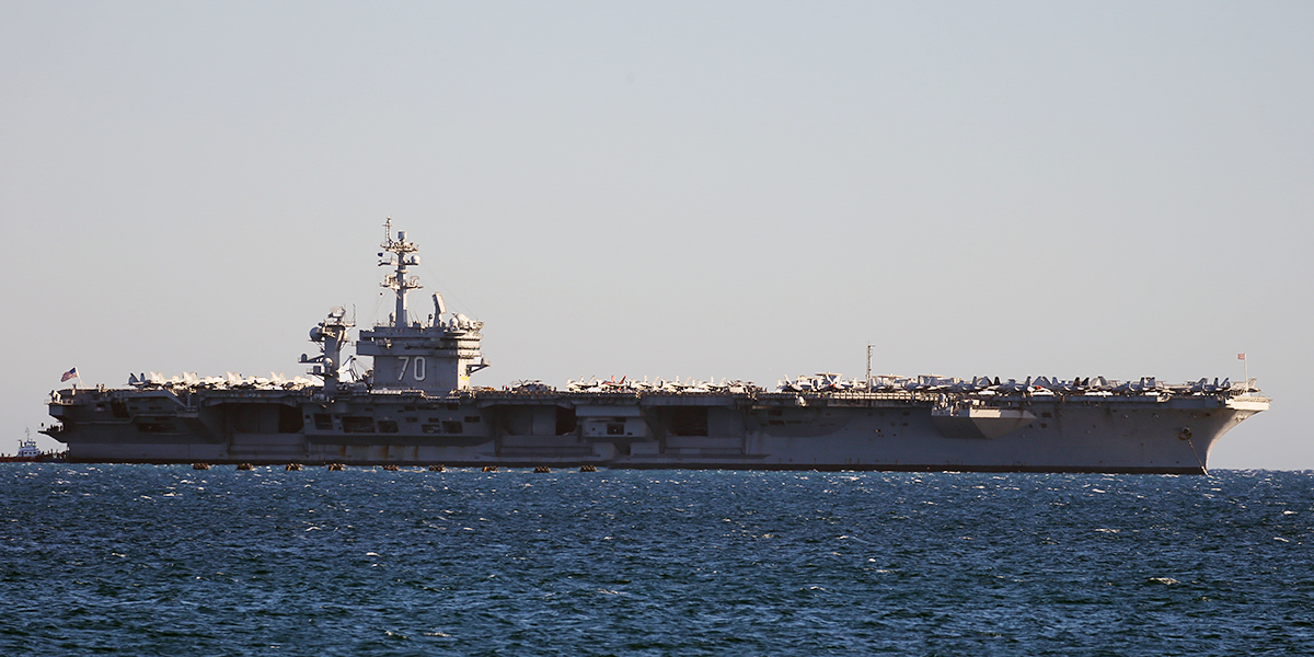 USS Carl Vinson (CVN-70) a Nimitz-class aircraft carrier, anchored at Gage Roads, off Fremantle - Sun 26 April 2015. Arrived today on a rest and recreation visit, before returning home to San Diego after an eight-month deployment, including six months of combat operations in the Arabian Gulf. Aboard were aircraft of Carrier Air Wing 17, which conducted strike operations against ISIS in the Middle East. Photo © Keith Anderson