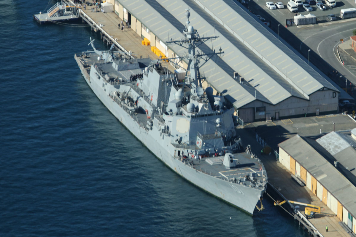 USS Gridley (DDG-101), an Arleigh Burke-class guided missile destroyer, with a Sikorsky MH-60R Seahawk of HSM-73 Battle Cats on the flight deck, at Victoria Quay, Fremantle Port - Sun 26 April 2015. Arrived today on a rest and recreation visit before returning home to San Diego, after an eight-month deployment, including six months of combat operations in the Arabian Gulf as part of the aircraft carrier USS Carl Vinson's Strike Group. Photo © David Eyre