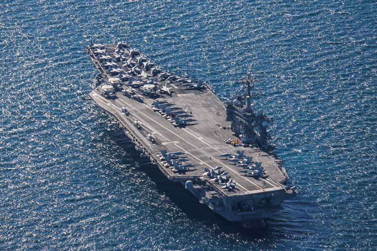 USS Carl Vinson (CVN-70) a Nimitz-class aircraft carrier, anchored at Gage Roads, off Fremantle - Mon 27 April 2015. Arrived today on a rest and recreation visit, before returning home to San Diego after an eight-month deployment, including six months of combat operations in the Arabian Gulf. Aboard were aircraft of Carrier Air Wing 17, which conducted strike operations against ISIS in the Middle East. Photo © Jonathan Williams