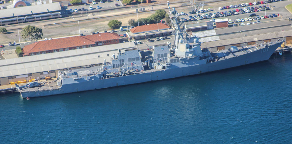 USS Gridley (DDG-101), an Arleigh Burke-class guided missile destroyer, with a Sikorsky MH-60R Seahawk of HSM-73 Battle Cats on the flight deck, at Victoria Quay, Fremantle Port – Mon 27 April 2015. Arrived 26 April 2015 on a rest and recreation visit before returning home to San Diego, after an eight-month deployment, including six months of combat operations in the Arabian Gulf as part of the aircraft carrier USS Carl Vinson's Strike Group. Photo © Geoff Selby