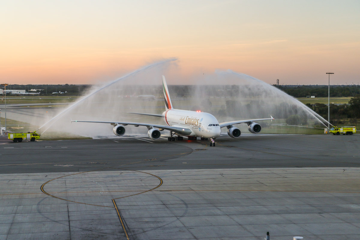 A6-EOE Airbus A380-861 (MSN 169) of Emirates, at Perth Airport - Fri 1 May 2015. First scheduled service to Perth by an A380. Flight EK420 from Dubai taxying in on Taxiway S at 5:36pm, receiving a traditional water cannon salute from airport fire crews. Photo © David Eyre